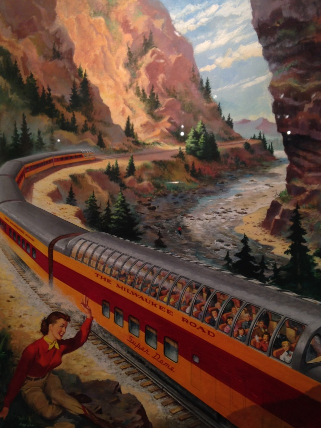 Girl and passing train, Milwaukee Road exhibit, Grohmann Museum, 2015