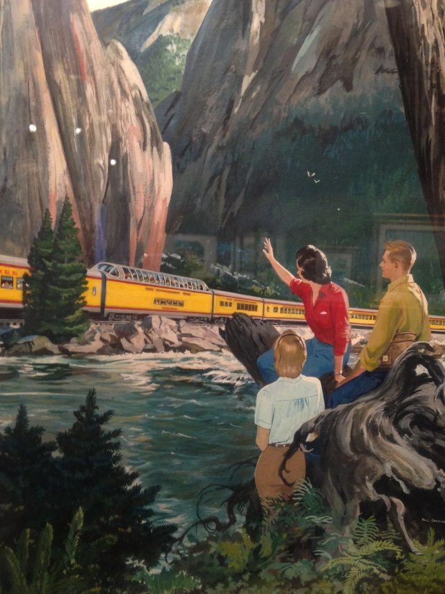 Trio waving to passing train, Milwaukee Road exhibit, Grohmann Museum, 2015