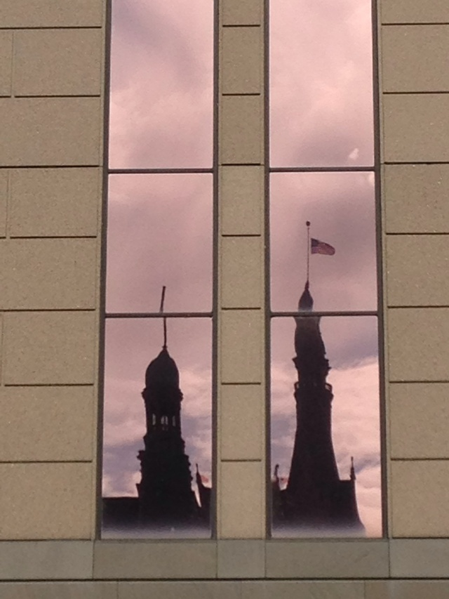 Milwaukee City Hall reflected in glass windows