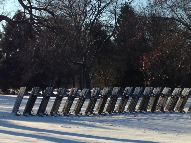 picnic tables, stacked together, winter