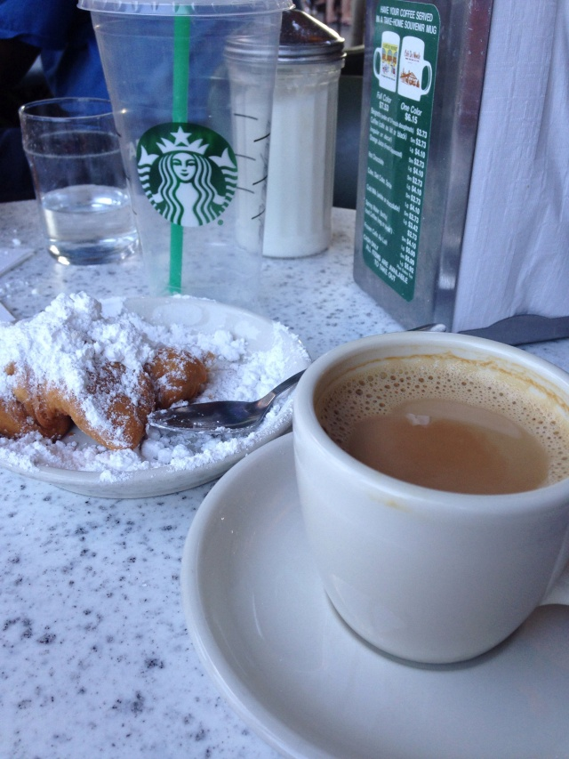 We were so hot that we stopped at Starbucks for cold drinks to sustain us on the walk up to the French Quarter, where we then ordered hot coffee. Hence Cindy's empty Starbucks cup on the table.