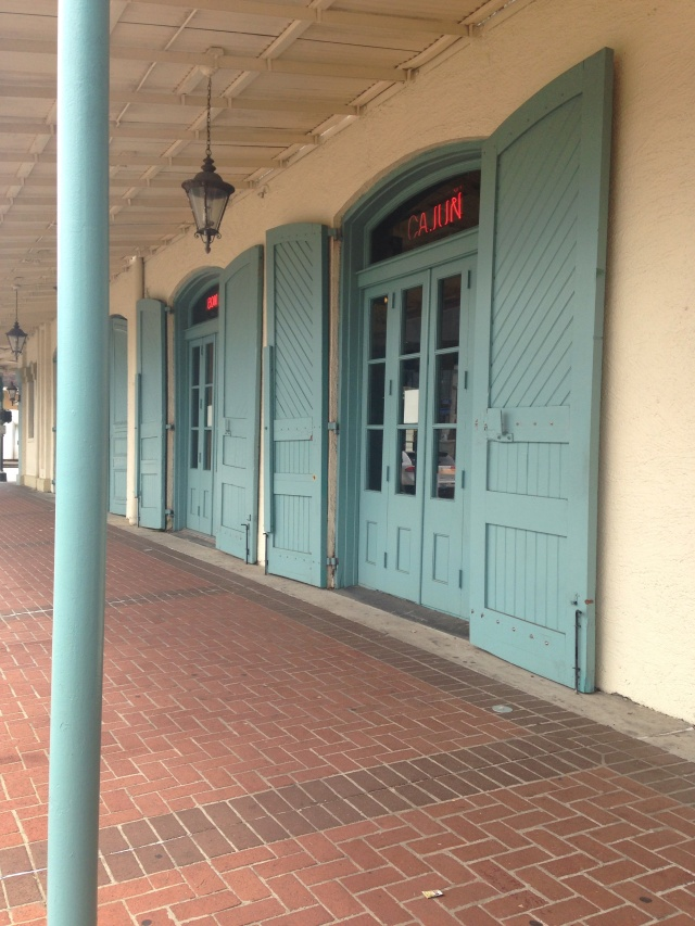 Shutters on French doors at Mulates in New Orleans