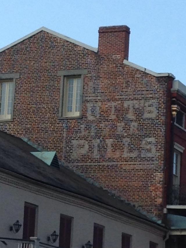 "Ghost sign ""Utt's Liver Pills"" seen in the French Quarter"