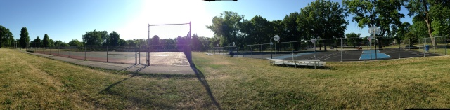 Abandoned and converted tennis courts panorama