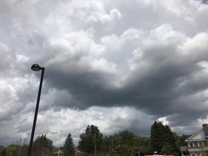 white clouds hanging low in a dark gray sky